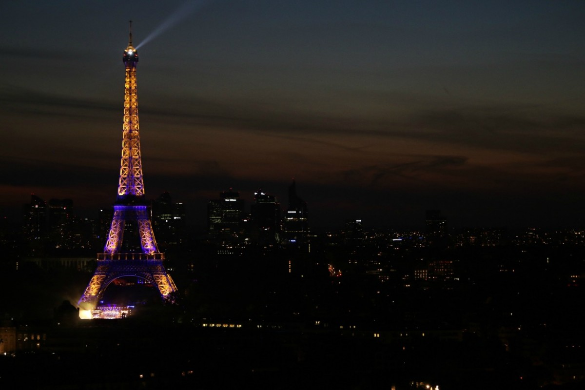 A view of the Eiffel Tower taken at night on Bastille Day, on the 21st floor of Montparnasse Tower, where we had class!